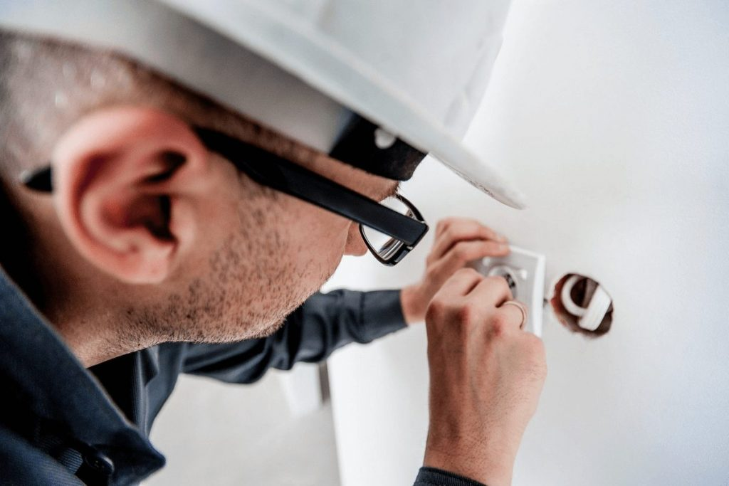 Local Electrician installing powerpoint